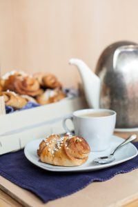 A typical Finnish bun, a cinnamon roll heady with cardamom and served with coffee. The name roughly translates as 'slapped ears', possibly due to it's unique shape.
